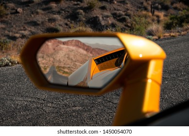 Looking at the rear view mirror in the desert.