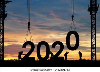 シルエットのスタッフがチームとして働き、2020年の新年を迎える準備をします