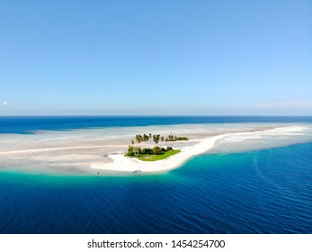 """Originally called Manimbora island in East borneo, but the locals call this island """"Spongebob island"""" instead. The resemblance from the sky is uncanny."""