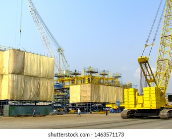 Offshore oil rig platform during construction site in the harbor yard.