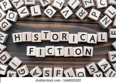 historical fiction - word from wooden blocks with letters, Literary Genres concept, random letters around, top view on wooden background