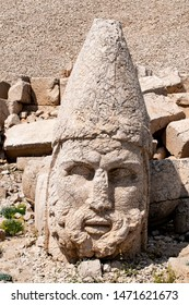 Kahta, Turkey: details of the west terrace of Nemrut Dagi, Mount Nemrut, with the tomb sanctuary of King Antiochus I of Commagene flanked by huge statues of himself and Greek, Armenian and Median gods
