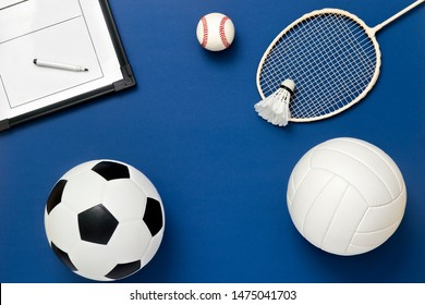 Assorted sports equipment on a blue background with copy space