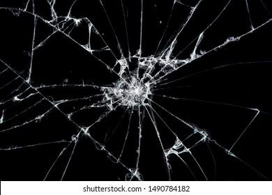 き裂を有するガラスの破片をテクスチャします。衝撃から割れた画面のスマートフォンの要約。