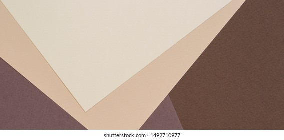 Color papers geometry composition background with beige and brown color tones