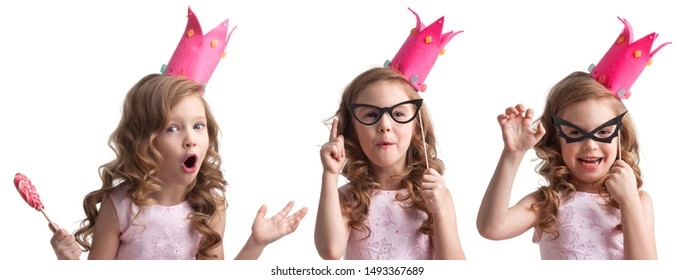 Beautiful little candy princess girl in crown bat mask, on fake glasses, with lollipop, halloween costume concept