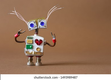 Funny robot toy cyborg with blue eye and red heart. Friendly comical mechanical toy character.