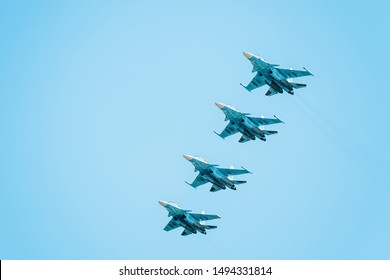 Airplanes with white smoke traces on air show. Pilots make tricks on Airforce jets at blue sky background.