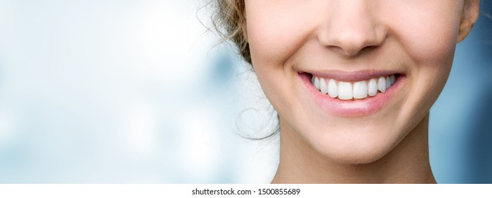 Beautiful wide smile of young fresh woman with great healthy white teeth. Isolated over background