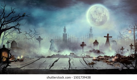 Halloween design with wooden table and graveyard. Spooky cemetery with tombs