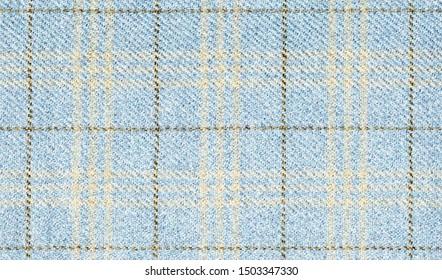 冬のジャケット。生地の幾何学模様。バージンウール極細。ブラウンクロスのライトブルー。Glenurquhartチェックはカシミアで作られています。伝統的なスコットランドのグレンチェック柄