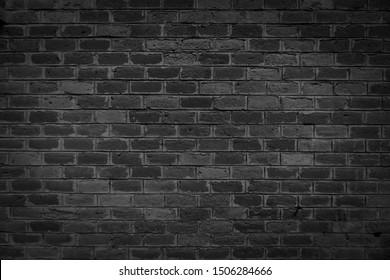 Oude bakstenen zwarte kleur muur. Vintage achtergrond