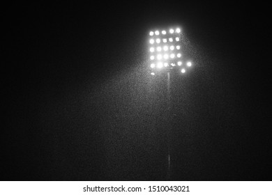 stadium lights reflectors against black background with rain drops