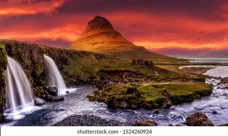 アイスランドの風光明媚なイメージ。日没時にカラフルな空とKirkjufell滝で有名なKirkjufellマウントの素晴らしい景色。素晴らしい自然の風景。風景写真家の象徴的な場所