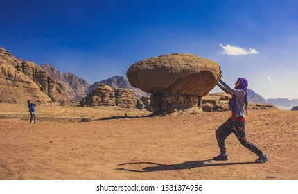 mainstream touristic photography with game of perspective and natural rocky architecture shapes in Wadi Rum Jordan Middle East desert picturesque scenic view beautiful travel destination place