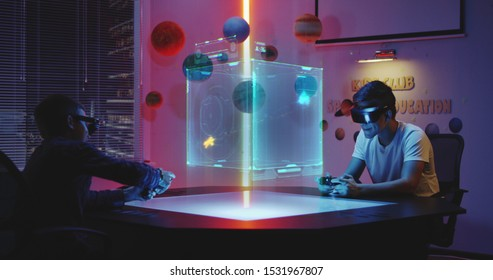 Medium long shot of teenagers playing holographic video game