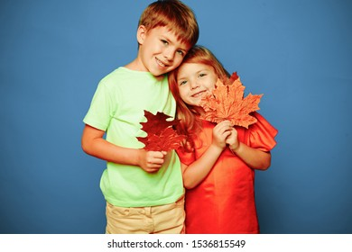 Place for your text. Happy kids. Autumn leaves background. Leaf fall happy people and joy. Hello november. Autumn Clothing and color trends. Leaf fall leaves isolated. Happy childhood