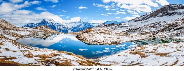 Banner of Bachalpsee lake in highlands of Grindelwald village in Switzerland. Winter scene. Panoramic view of iconic Swiss mountain lake - Bachalp. Popular trekking spot, view on Matterhorn peak.