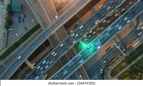 Beautiful aerial presentation of the autonomous cars self-driving concept on multi-level highway in Moscow. Direct view from above to the road traffic in a big city on the sunny evening.
