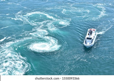 The world largest whirlpools in Naruto Channel and a sightseeing boat.