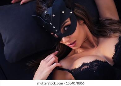 Close up sexy model wearing a batman mask.