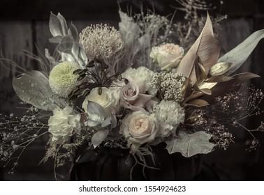 Floral arrangement of fresh flowers in black pumpkin. The concept of autumn holidays. Halloween's