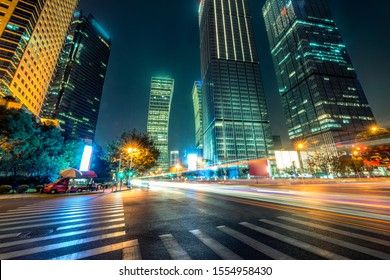 modern city of shanghai in a beautiful night ,futuristic urban building with light trails