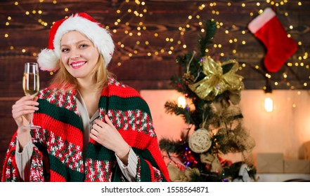 Dear santa. xmas morning joy. woman santa hat at decorated new year tree. ready for holidays. happy woman in cozy plaid. girl drink champagne. happy new 2020 year. merry christmas.