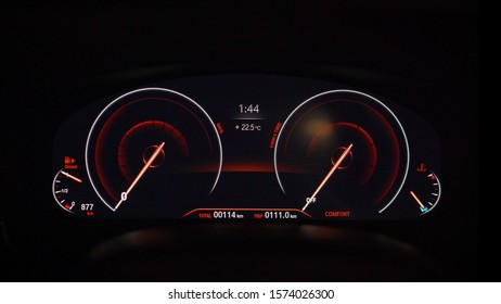 The dashboard on the car is lit in red