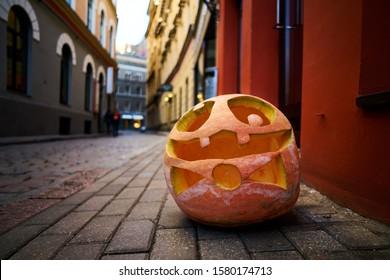 Halloween Pumpkin on old town street in Riga.