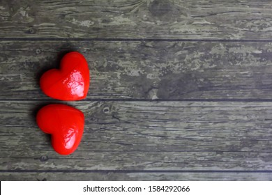 two stones in the shape of a heart on wooden background - Valentine's Day card Concept