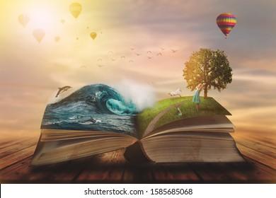 Concepto de libro mágico abierto; páginas abiertas con agua y tierra y niño pequeño. Concepto de fantasía, naturaleza o aprendizaje, con espacio de copia