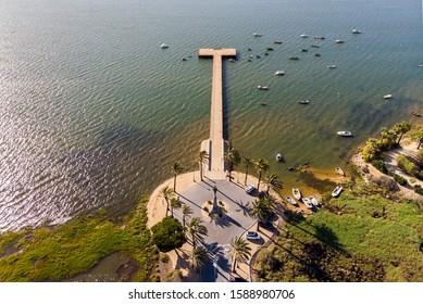 Aerial panorama of Muelle de la Reina, Plus Ultra monument, near Caravel dock with Christopher Columbus ships, La Rabida village, Huelva, Andalusia, Spain