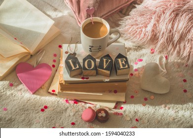 Love concept for mothers day and valentines day. Hearts and the books with cup coffee. Happy Valentines Day and mother's day postcard.