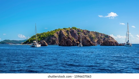 A view sailboats moored of the Pelican island and the Indian Islets off the main island of Tortola