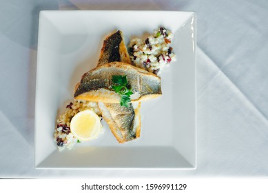 Fish dish - fish fillet and vegetables in restaurante
