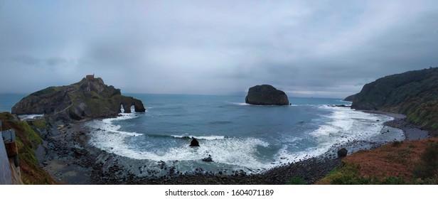 Maritime landscape with cliffs. Dragon rock castle in San Juan de Gaztelugatxe, Spain.