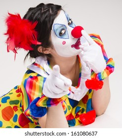 Colorful female clown actress speaking out having fun circus entertainer