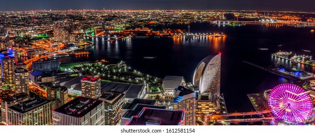 Yokohama, Japan - YOKOHAMA city - MINATOMIRAI, Panorama twilight cityscape and skyline of Yokohama from the Yokohama bay during sunset from the observation tower of Landmark Tower.