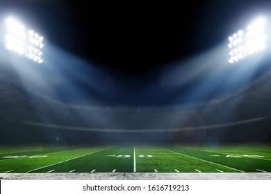 明るいライトのあるアメリカンフットボールスタジアム