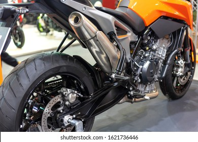 Back view of the wheel and the exhaust of a Motorcycle.