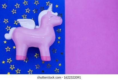 Pink unicorn, Pegasus on a dark blue background
