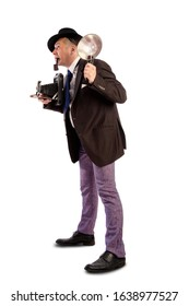 Comic character old photojournalist with camera and flash in a hat and a fashionable suit of those times at a photo shoot