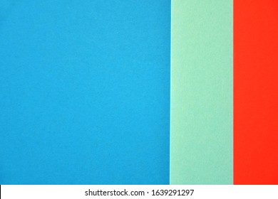 Abstract modern background with blue mint and lush lava colors. Minimal contemporary design. Colorful paper color blocks mock up. Trendy color block design. Textured geometric background