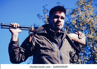 Closed and open hunting season. Man holding shotgun. Poacher with Rifle Spotting Some Deers. Illegal Hunting Poacher in the Forest