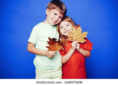 Place for your text. Happy baby. Autumn leaves background. Leaf fall happy people and joyHello november. Autumn Clothing and color trends. Leaf fall leaves isolated. Happy childhood