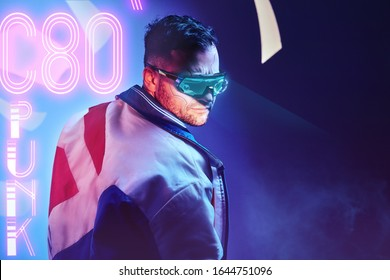 Handsome cyborg man wearing modern clothes and futuristic smart vision glasses. Cyberpunk concept art
