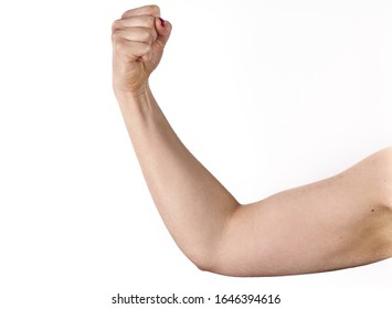 closeup picture of sporty woman flexing her biceps.