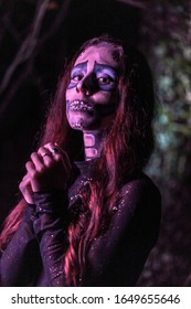 Halloween, a young girl dressed as a Mexican skull with purple lighting