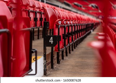 Red stadium chairs of empty line number four